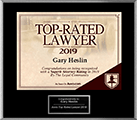 Logo Recognizing Heslin Law Firm's affiliation with AVVO Top Rated Lawyer